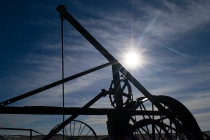 Contrejour, against the sun--creating silhouettes from old farm equipment.